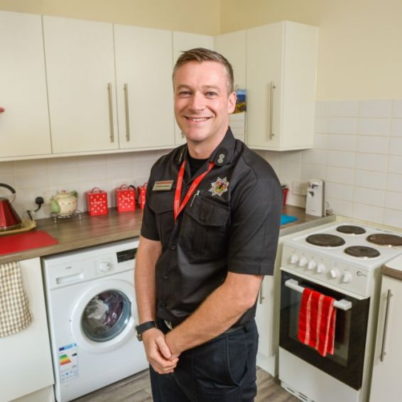 Fire officer in kitchen