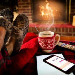 Warm home discount feet up by an open fire