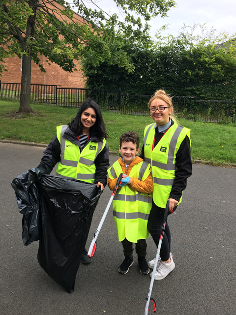 School kids help with the clear up in Darnley